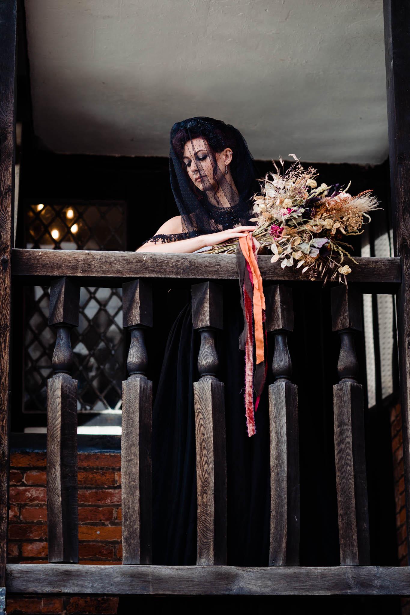 halloween wedding - bride in black wedding dress and black veil - autumn gothic wedding