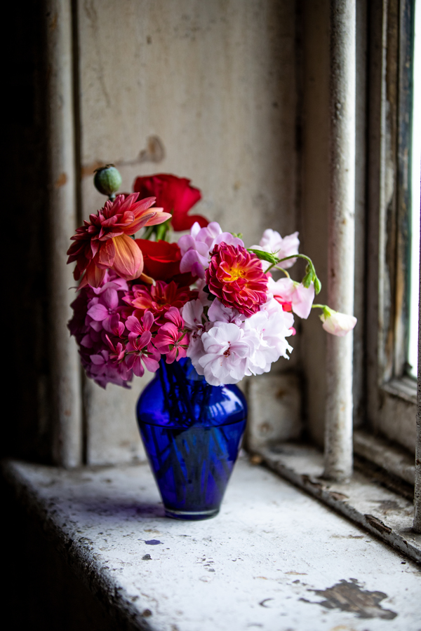 pink wedding flowers in blue vase