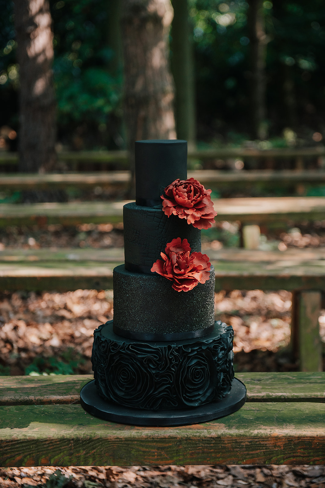 black wedding cake with red flowers - gothic wedding cake - unique wedding cake