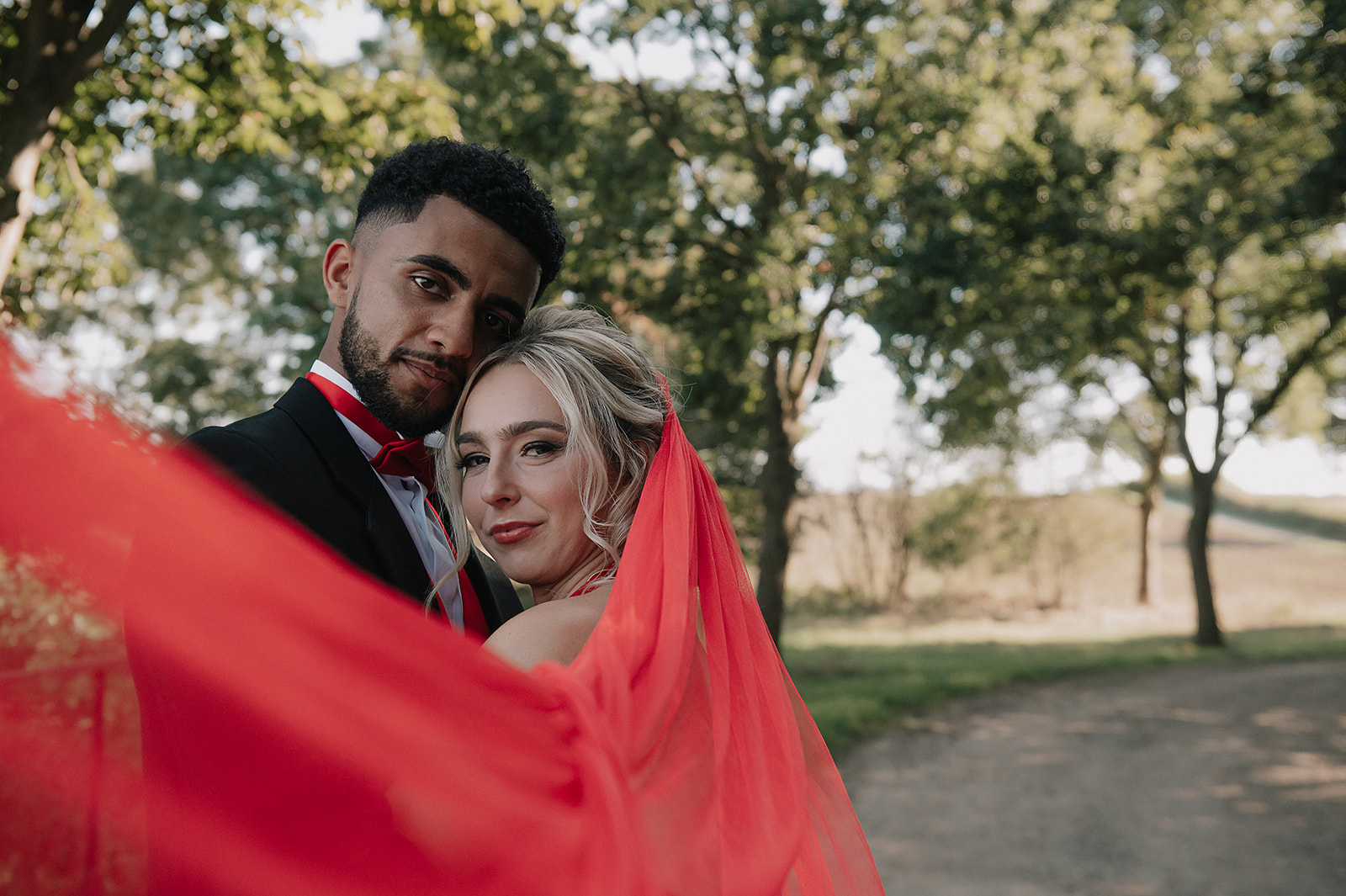 red wedding - forest elopement photoshoot - red wedding veil - red bowtie - red wedding colour scheme
