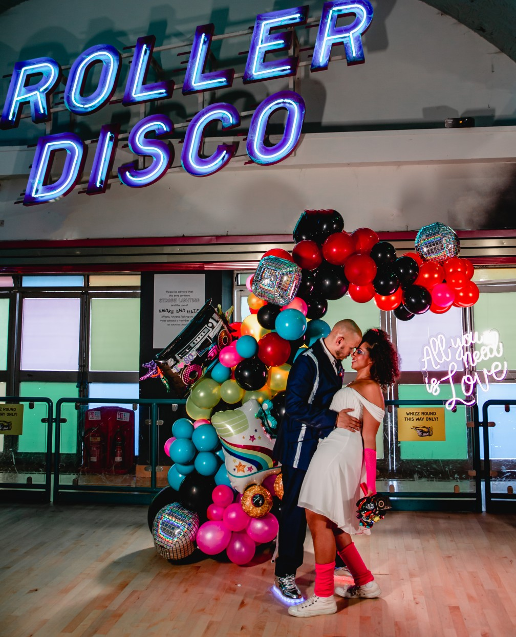 fun wedding balloons - 80s wedding balloons - roller disco wedding - colourful wedding - retro wedding