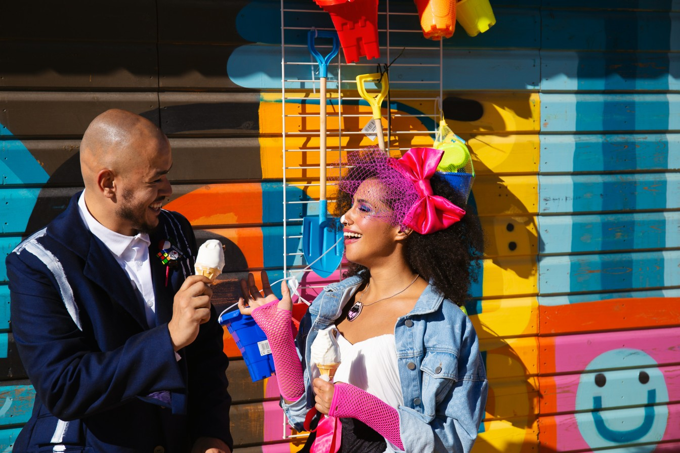 bride and groom eating ice cream - fun wedding photos - 80s wedding wear - colourful wedding
