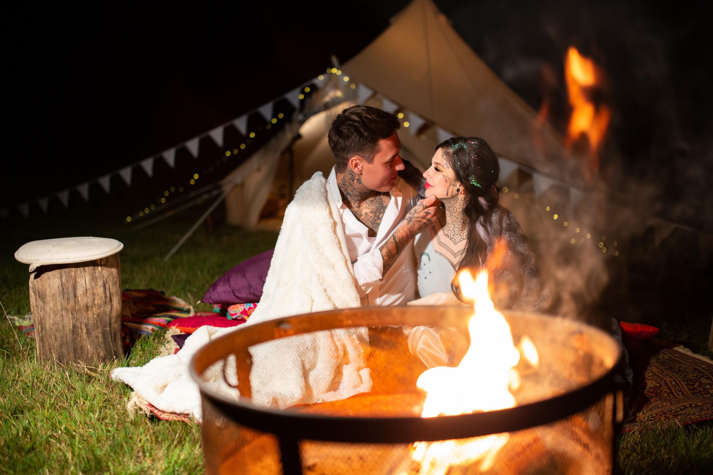 festival wedding - bride and groom at campfire - tipi wedding