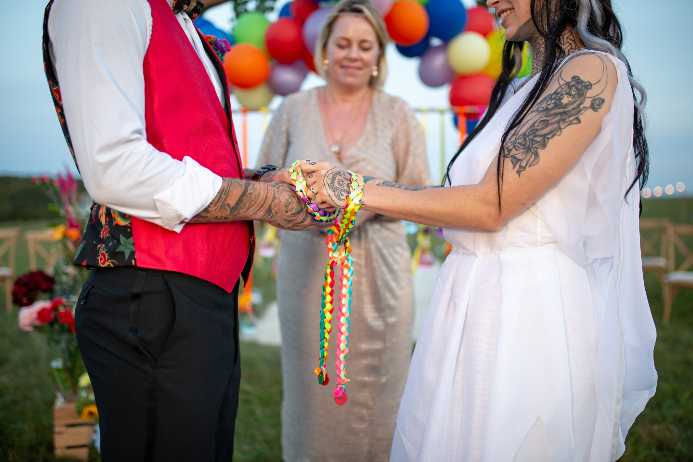 rainbow festival wedding - colourful wedding - quirky wedding ideas - handfasting ceremony with colourful ribbon