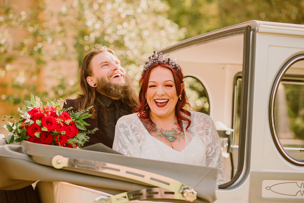 bride and groom in wedding car laughing, alternative wedding, fun wedding, pandemic wedding