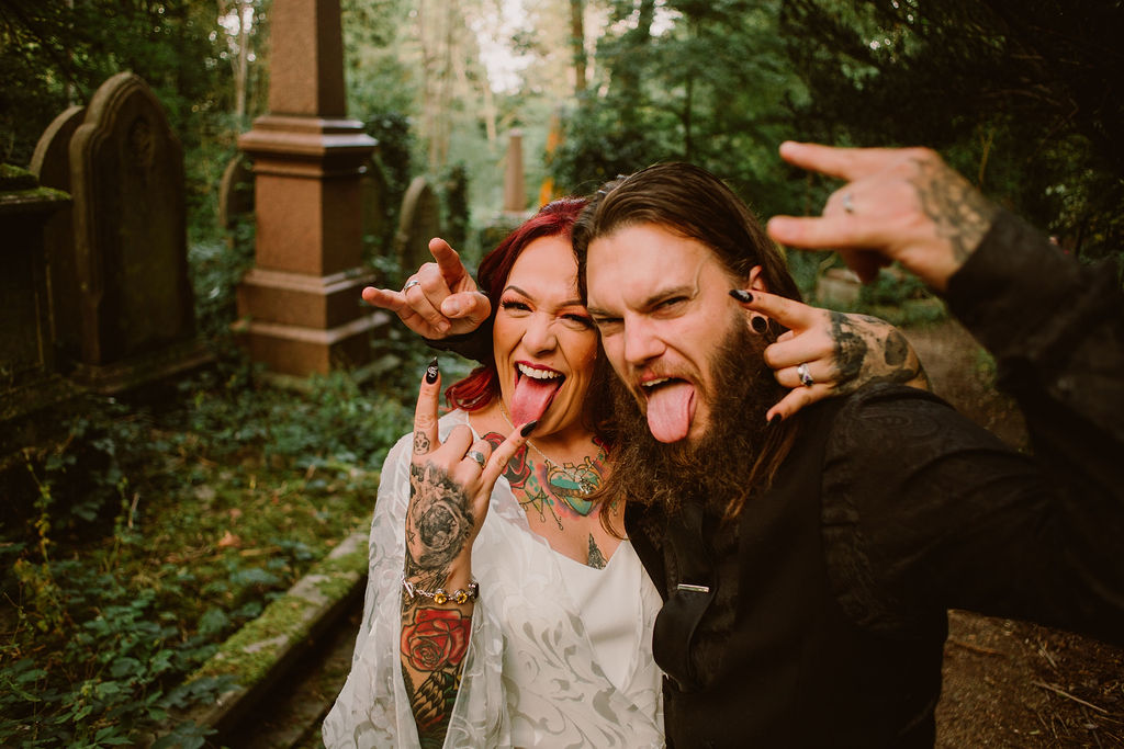 rock and roll bride and groom - alternative couple - bride and groom sticking their tongues out