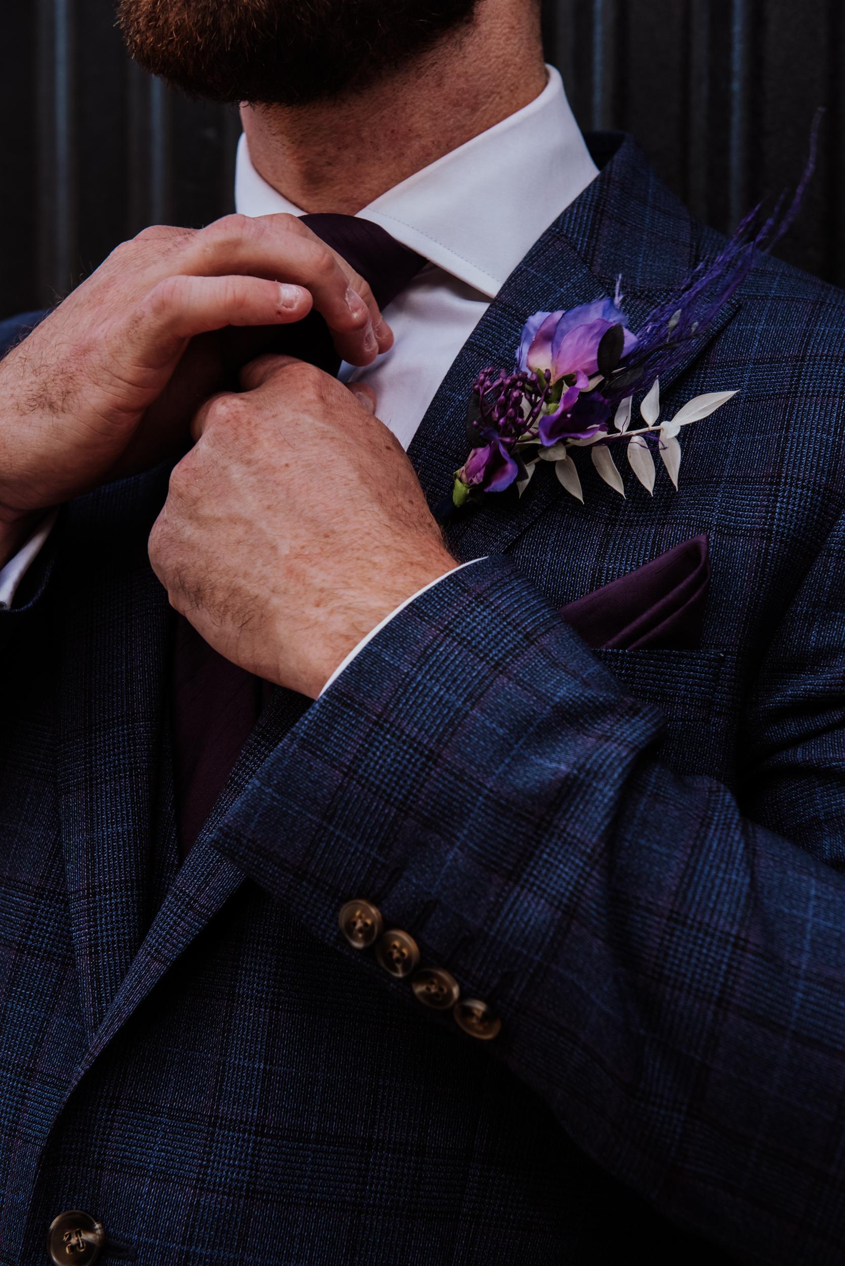 mens blue and purple tweed suit - purple buttonhole