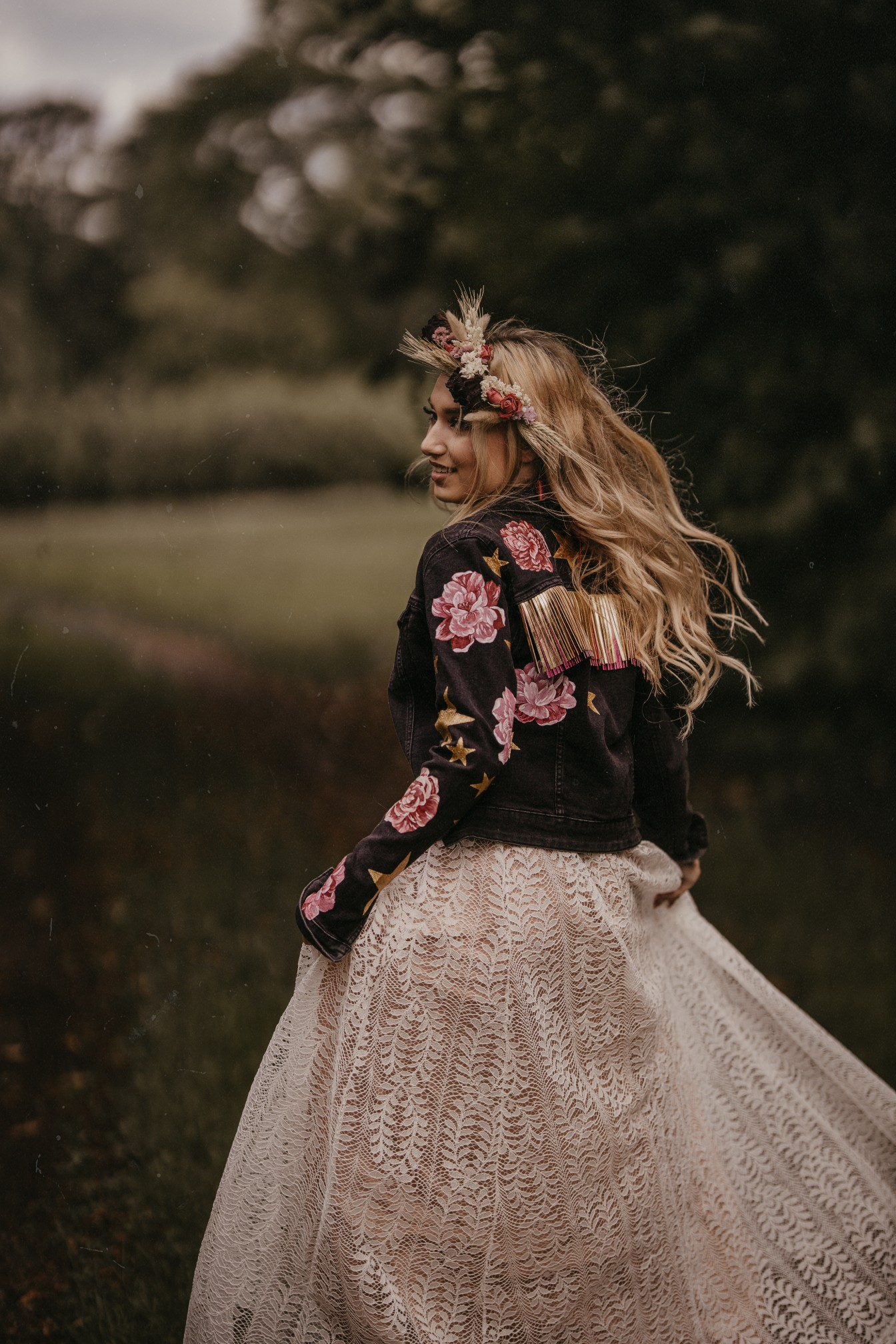 bride running in the forest - fairytale boho wedding - bride in hand painted denim jacket and flower crown