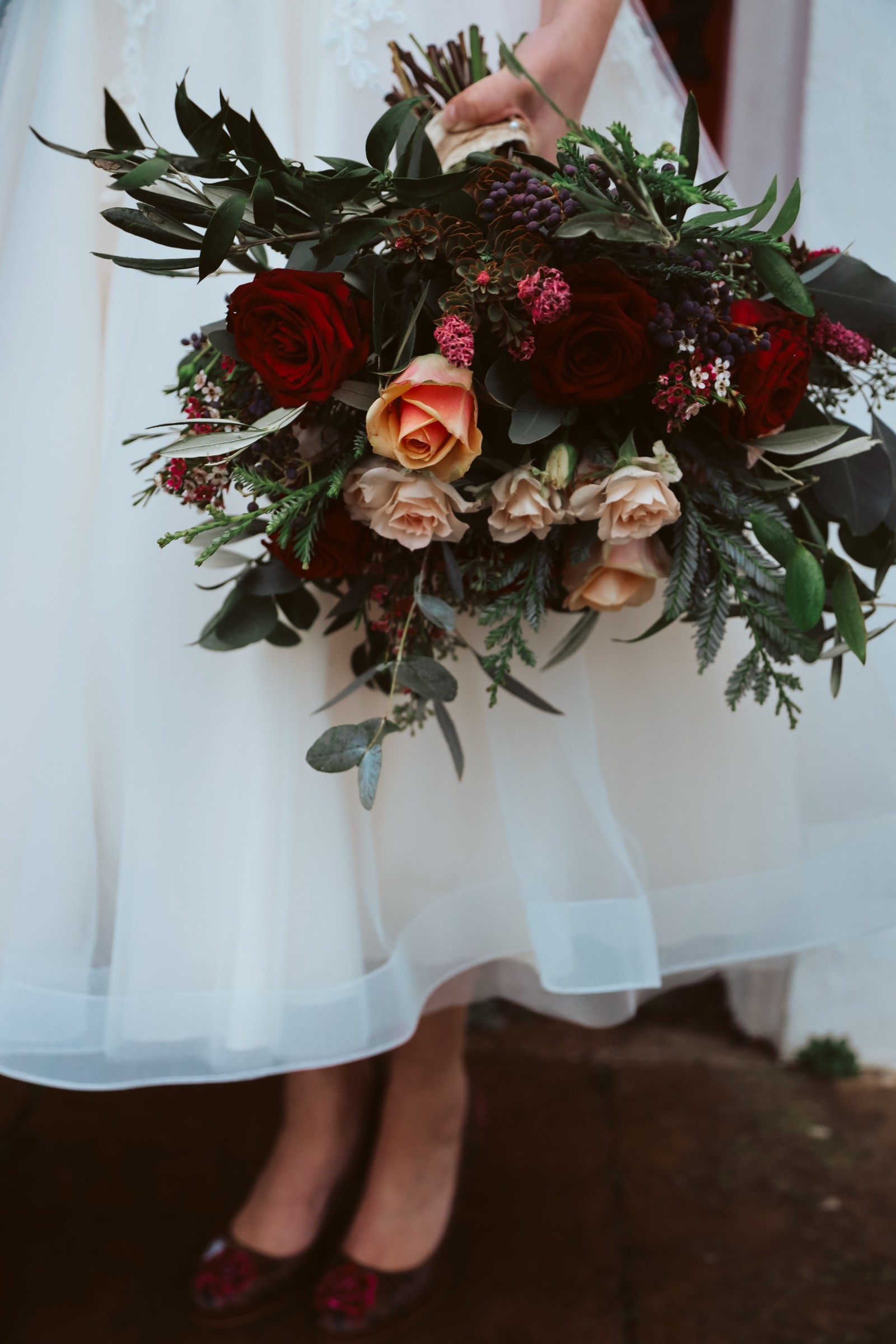 Great Betley Farmhouse wedding venue - Christmas micro wedding - christmas wedding - nhs wedding - wedding flowers with shades of red and peach