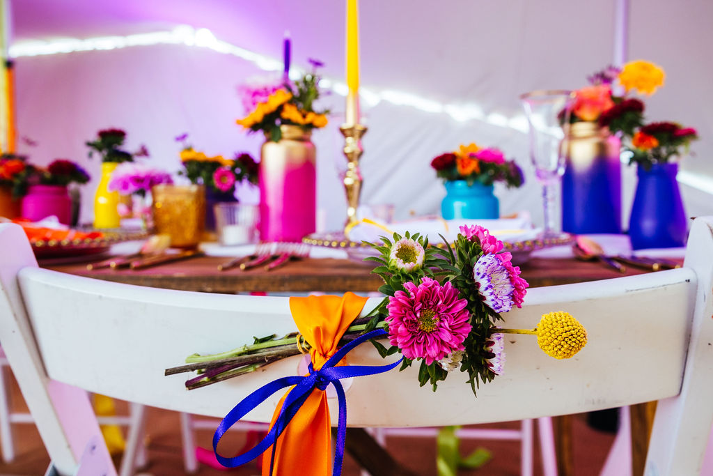 bright festival wedding - colourful wedding flowers - colourful wedding chair decoration - eclectic wedding flowers