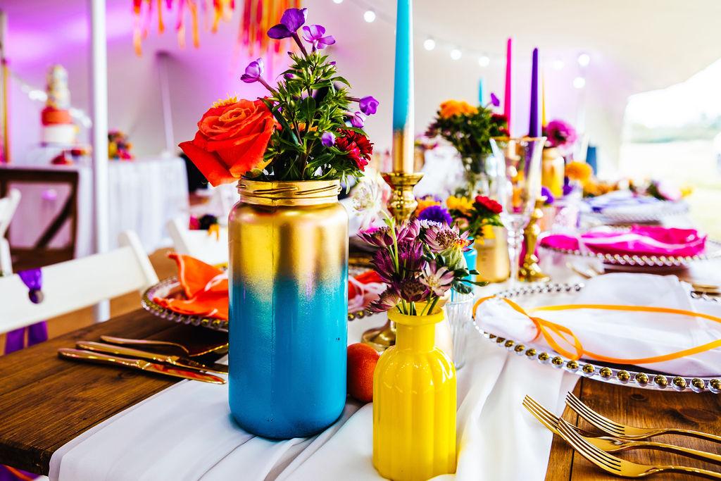 bright festival wedding - colourful wedding flowers - colourful wedding table styling - eclectic wedding vases - marquee wedding styling
