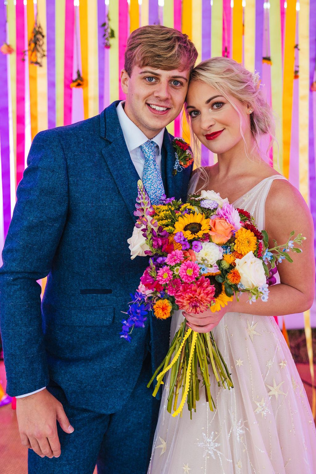 bright festival wedding - colourful wedding- colourful wedding flowers - rainbow wedding backdrop - ribbon wedding backdrop