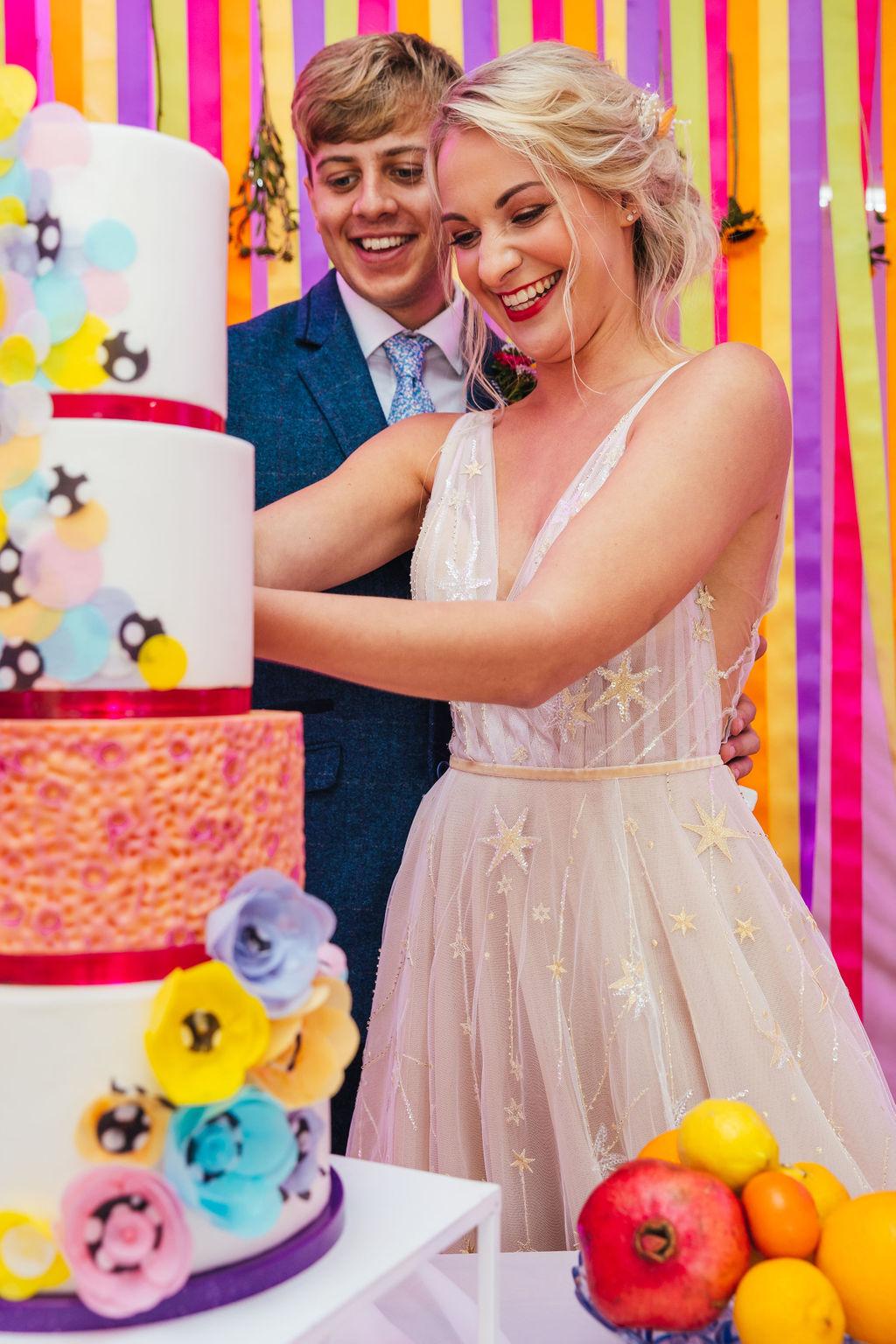bright festival wedding - colourful wedding - colourful wedding cake - colourful wedding backdrop - unconventional wedding