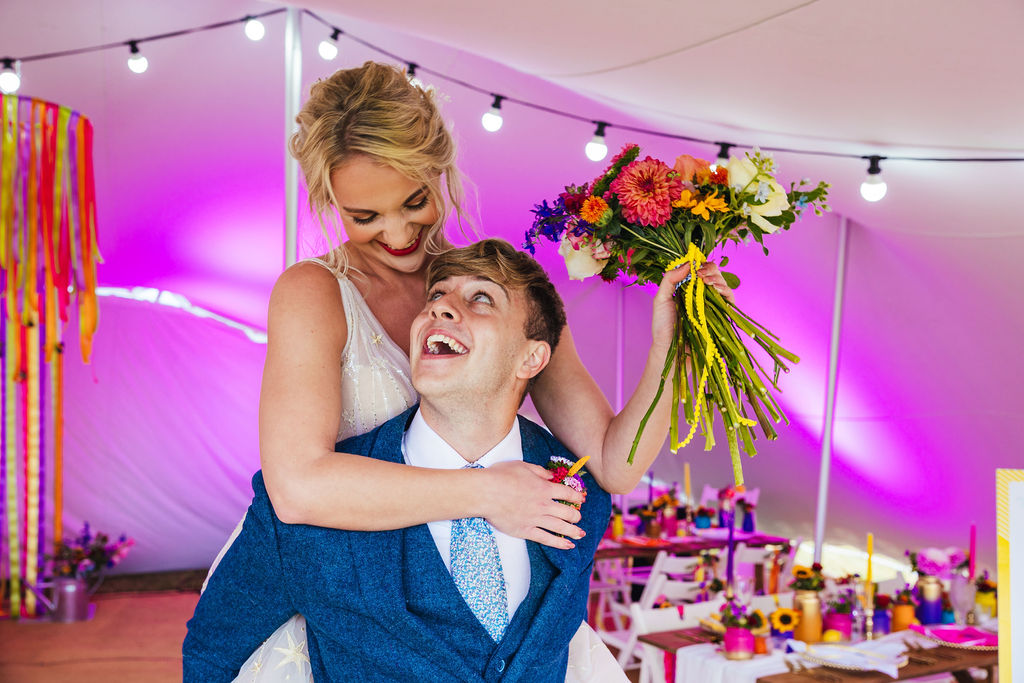 bright festival wedding - colourful wedding - colourful wedding flowers - colourful marquee wedding