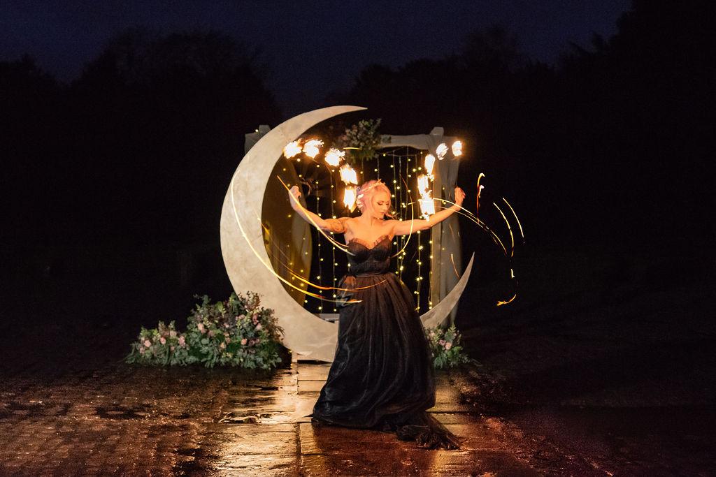 wedding fire performer - wedding moon prop - quirky wedding prop hire- black wedding dress