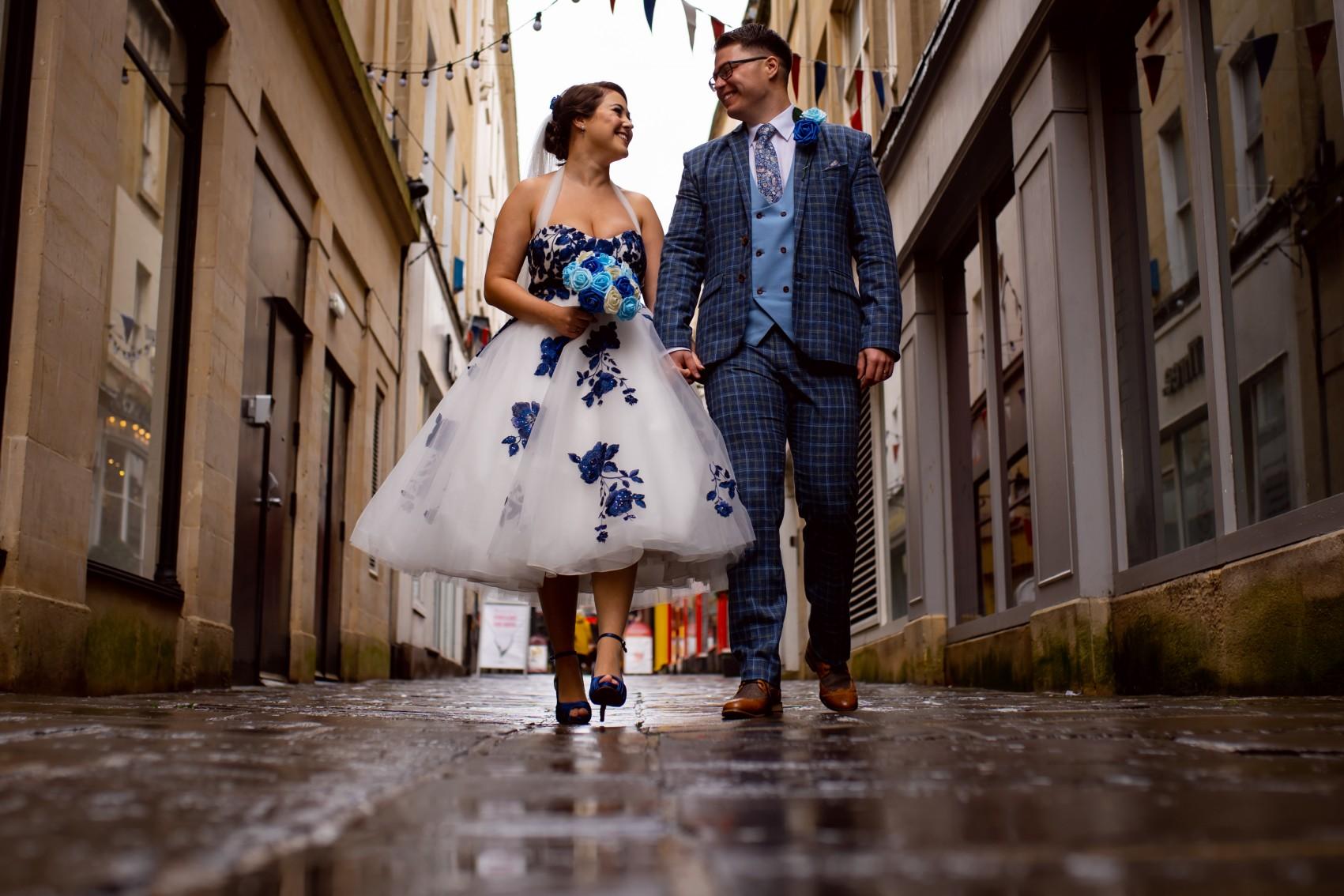 alternative bridal wear - tea length wedding dress with blue flowers - alternative wedding wear