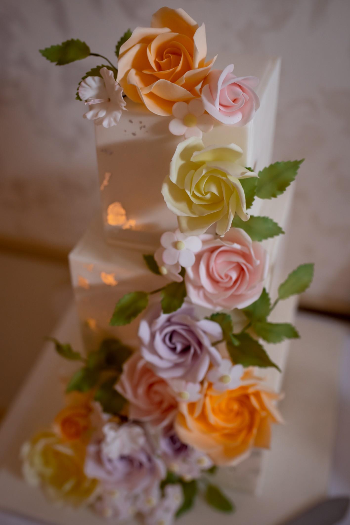 square wedding cake with pastel flowers - unique wedding cake - pastel wedding cake
