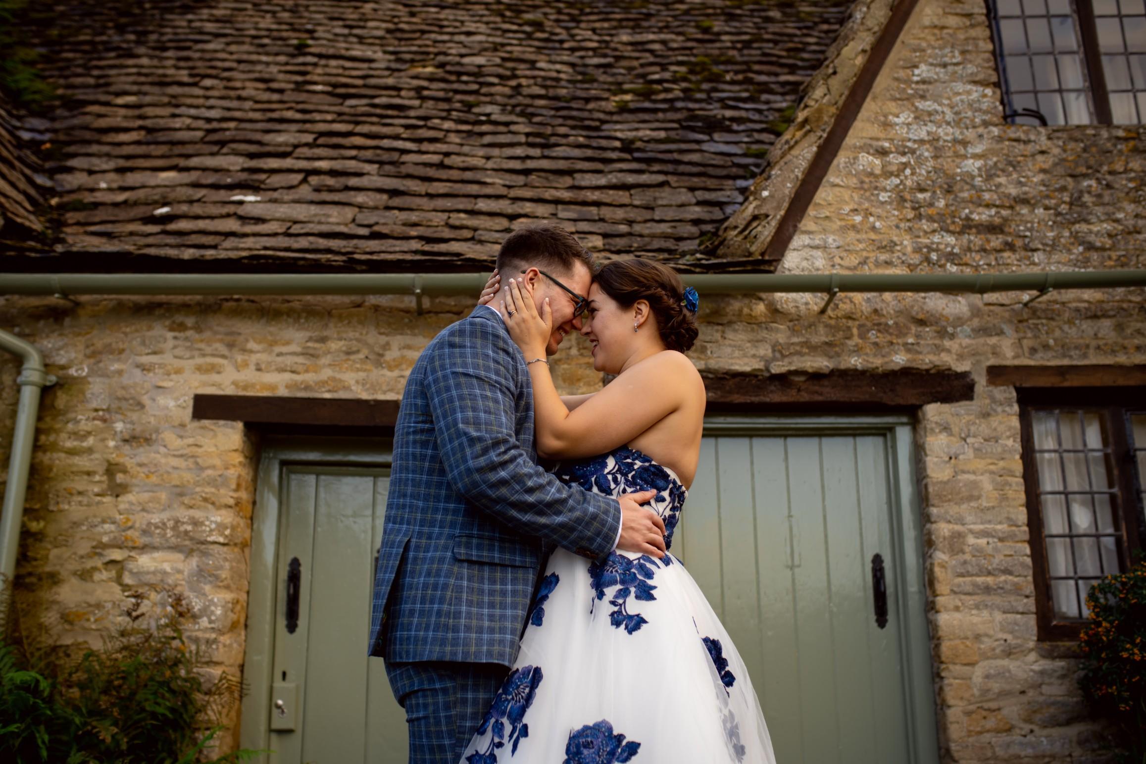 cotswolds wedding shoot - unique wedding dress and blue grooms suit