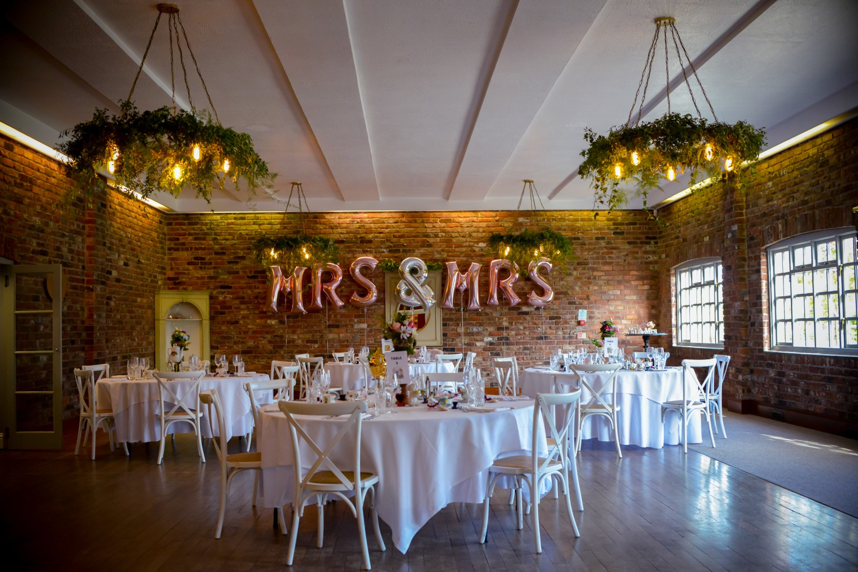 romantic wedding styling with mrs&mrs balloons