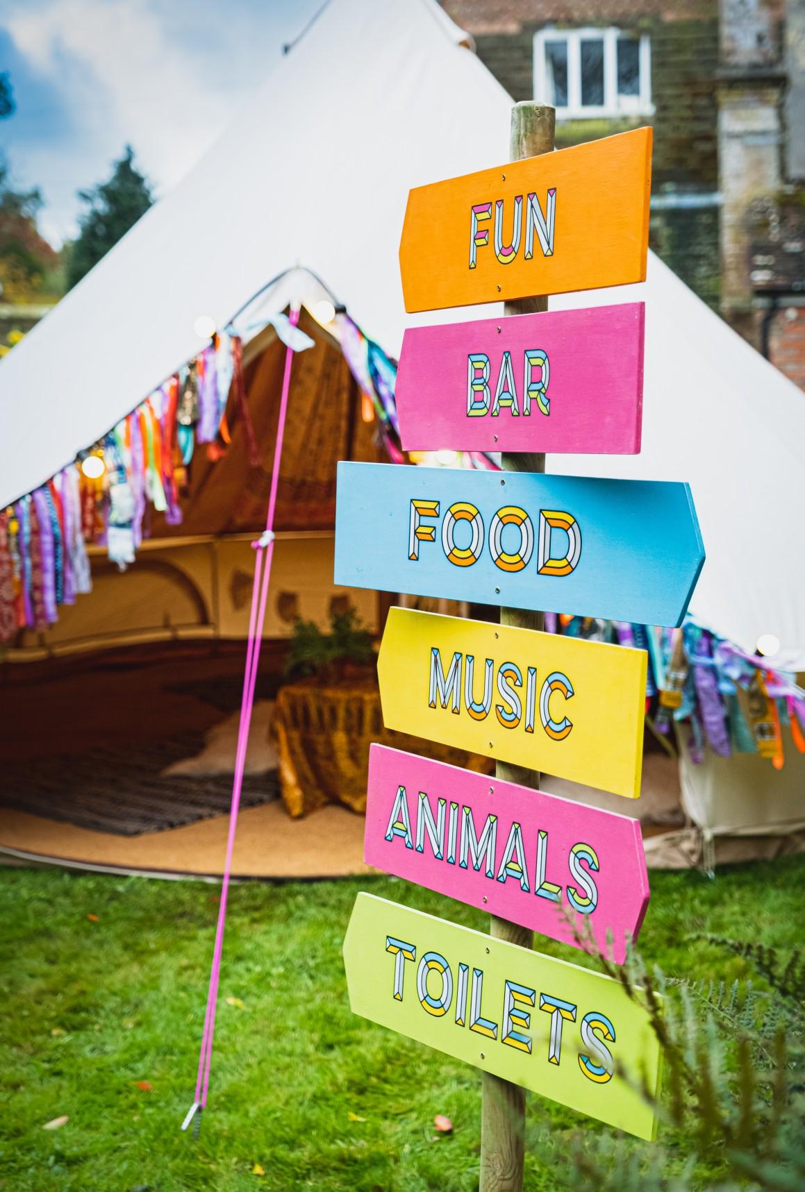 colourful micro wedding at patricks barn - festival wedding signage - unique wedding signs - festival wedding - colourful wedding - boho wedding