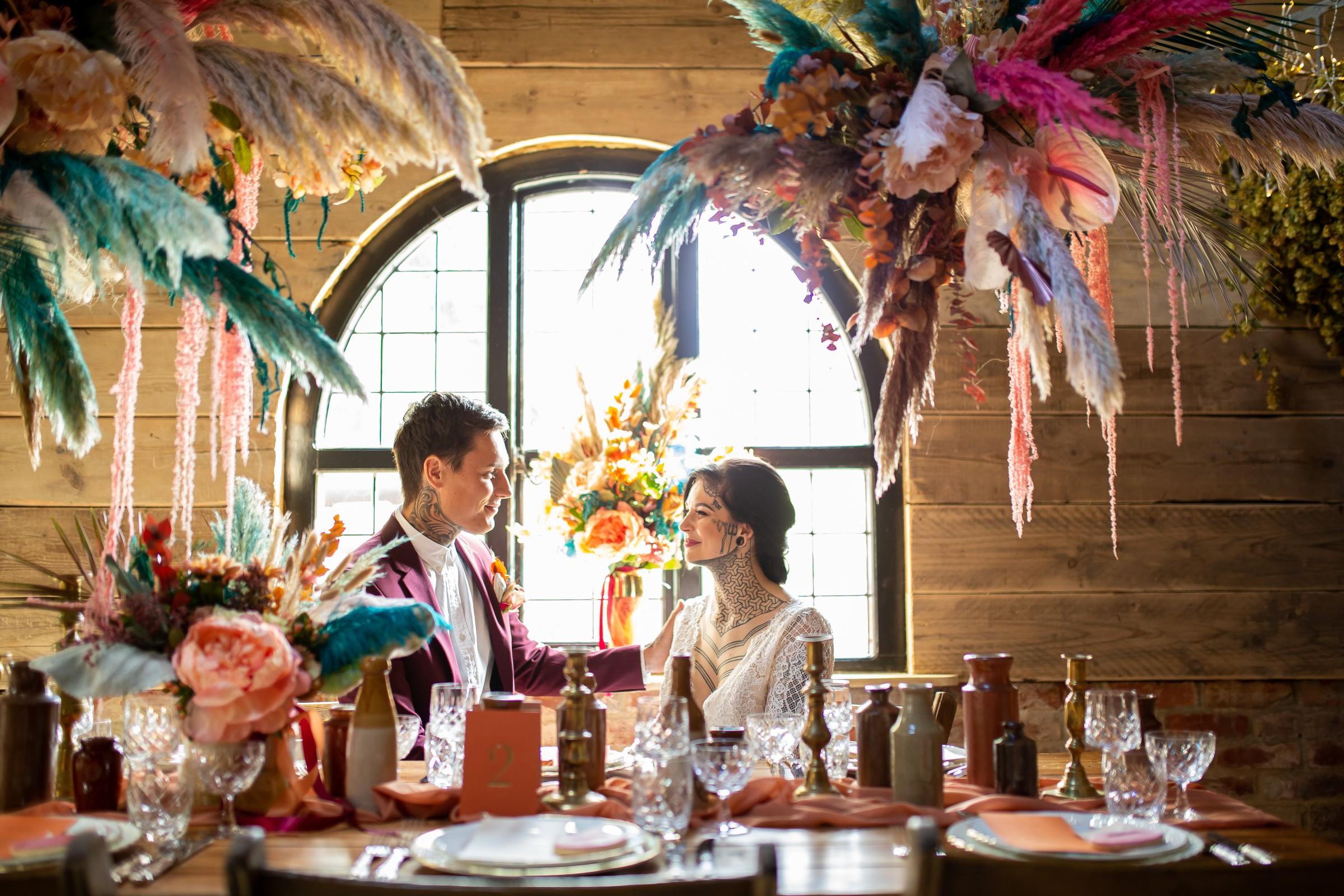unique barn wedding - creative wedding styling - bright wedding - modern wedding - unique wedding flowers - colourful wedding flowers - wedding table styling - unconventional wedding