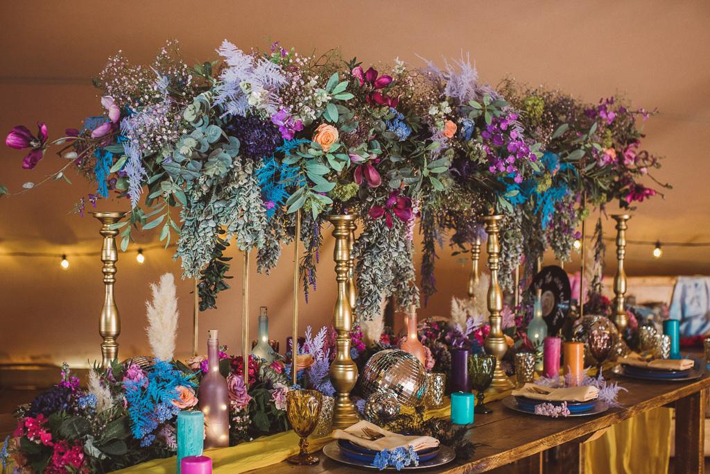colourful wedding flowers - colourful wedding cake - festival wedding flowers - hot pink wedding cake - colourful festival wedding decor - bold wedding flowers - statement wedding flowers