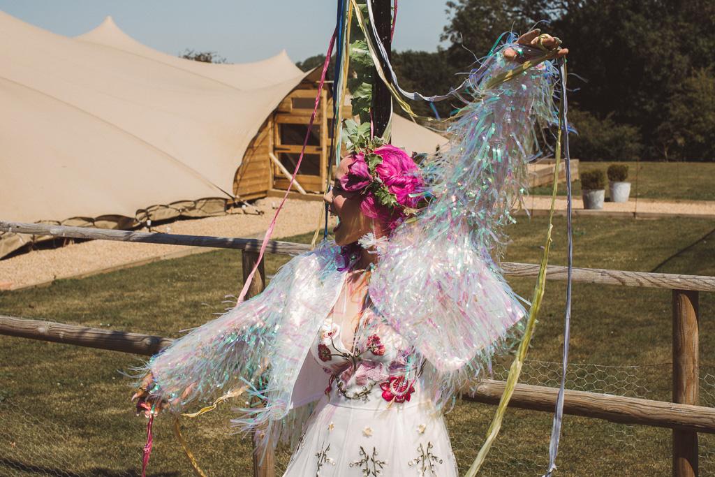 fun festival wedding - festival bride in tassel jacket - alternative bridal wear - unique wedding wear
