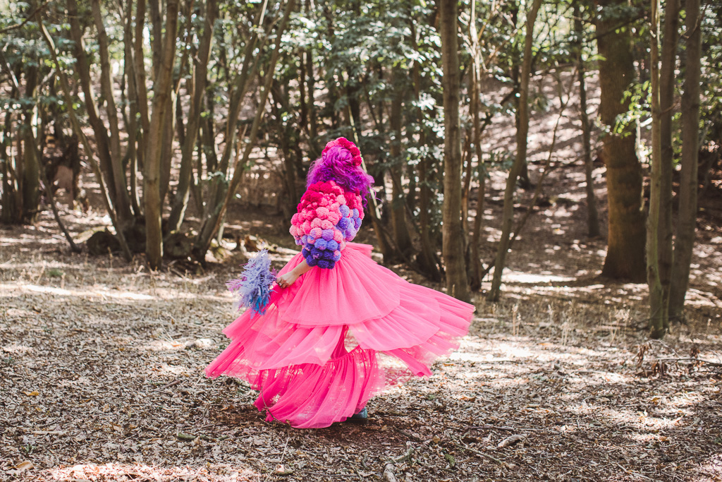 fun festival wedding - bridal pom pom jacket - pink bride - festival bride - coloured wedding dress - colourful wedding dress - bridal pom pom headdress - unconventional wedding - pink wedding dress