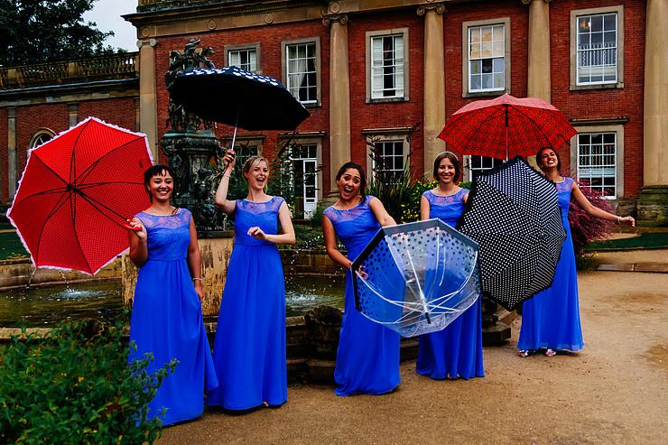 rainy wedding - rain wedding advice - fun wedding planning - wedding planning blog - rain wedding photos - bridesmaids with umbrellas