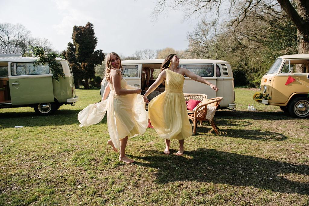 camper van wedding - yellow bridesmaids dresses - bridesmaids dancing