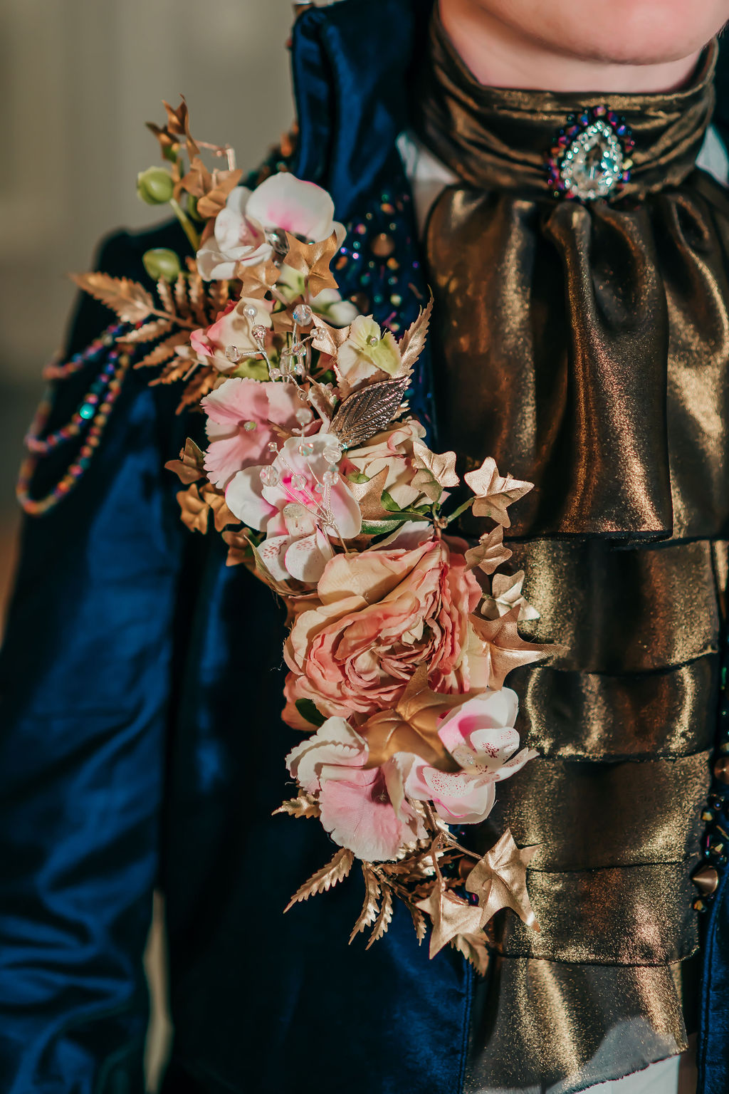 Groom style for labyrinth movie wedding day with flower shoulder pad and gold neck ruffle with jewels