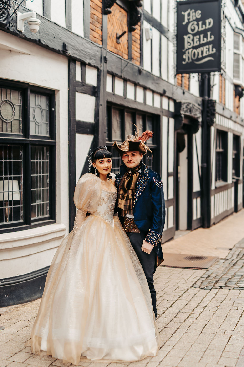 Labyrinth themed wedding day - couple standing outside the old bell hotel derby