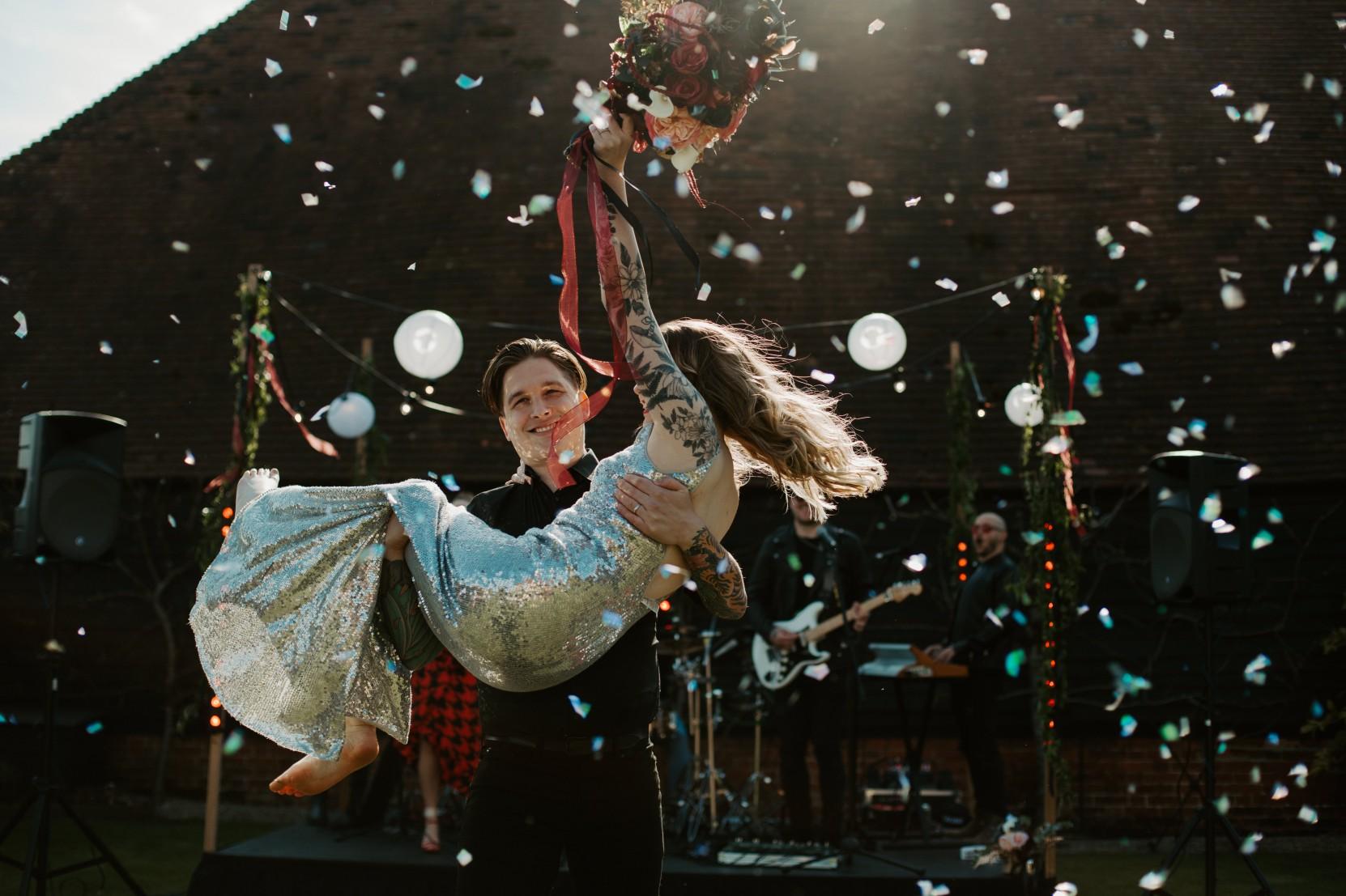 rock and roll wedding - edgy wedding inspiration - wedding confetti photo - sparkly wedding dress - sequin wedding dress