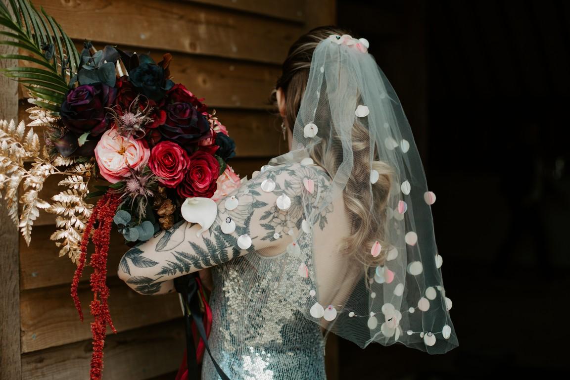 rock and roll wedding - edgy wedding inspiration - unique wedding veil - unique wedding flowers