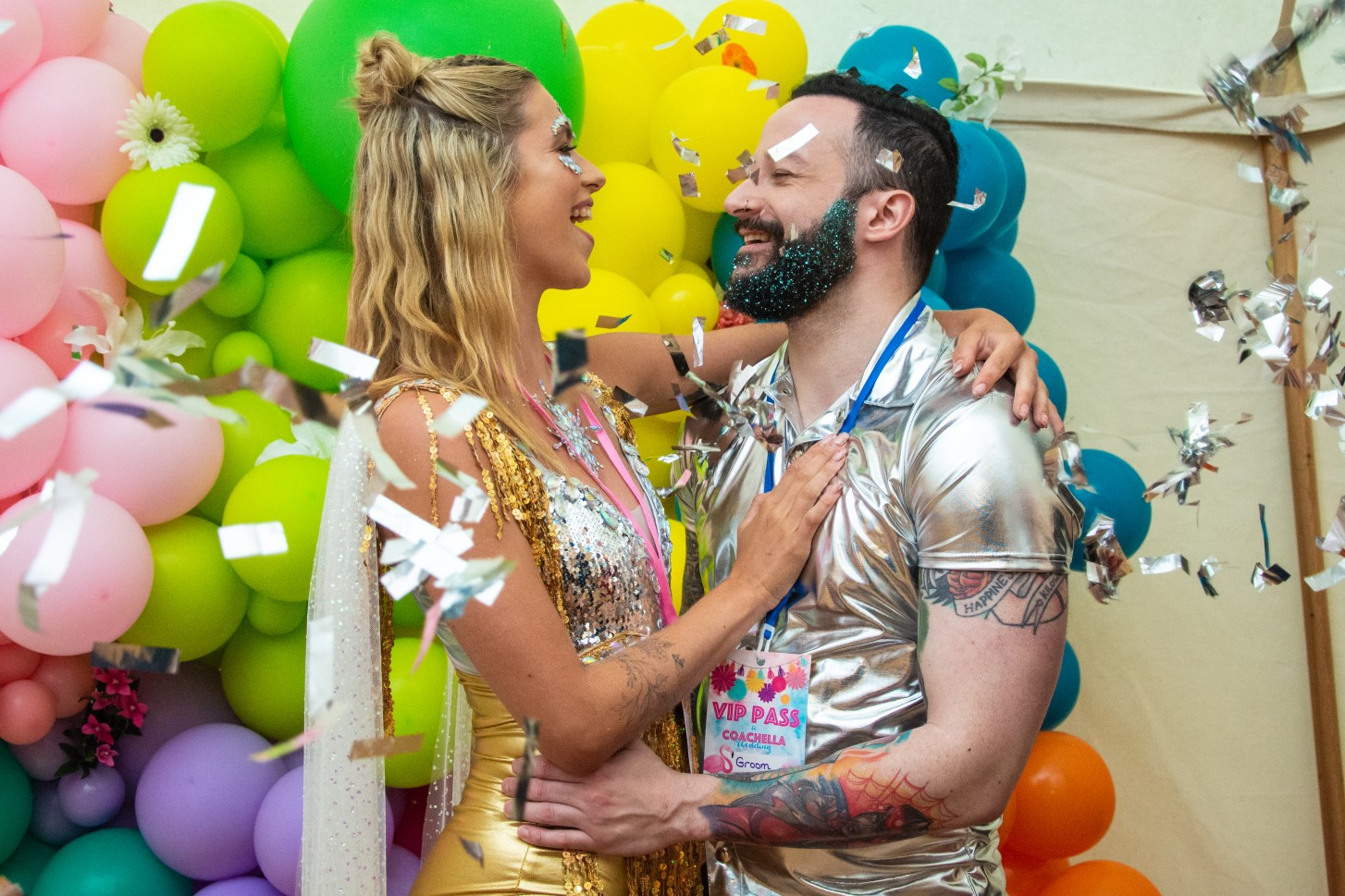 sparkly festival wedding - colourful wedding - festival wedding confetti shot - colourful wedding backdrop