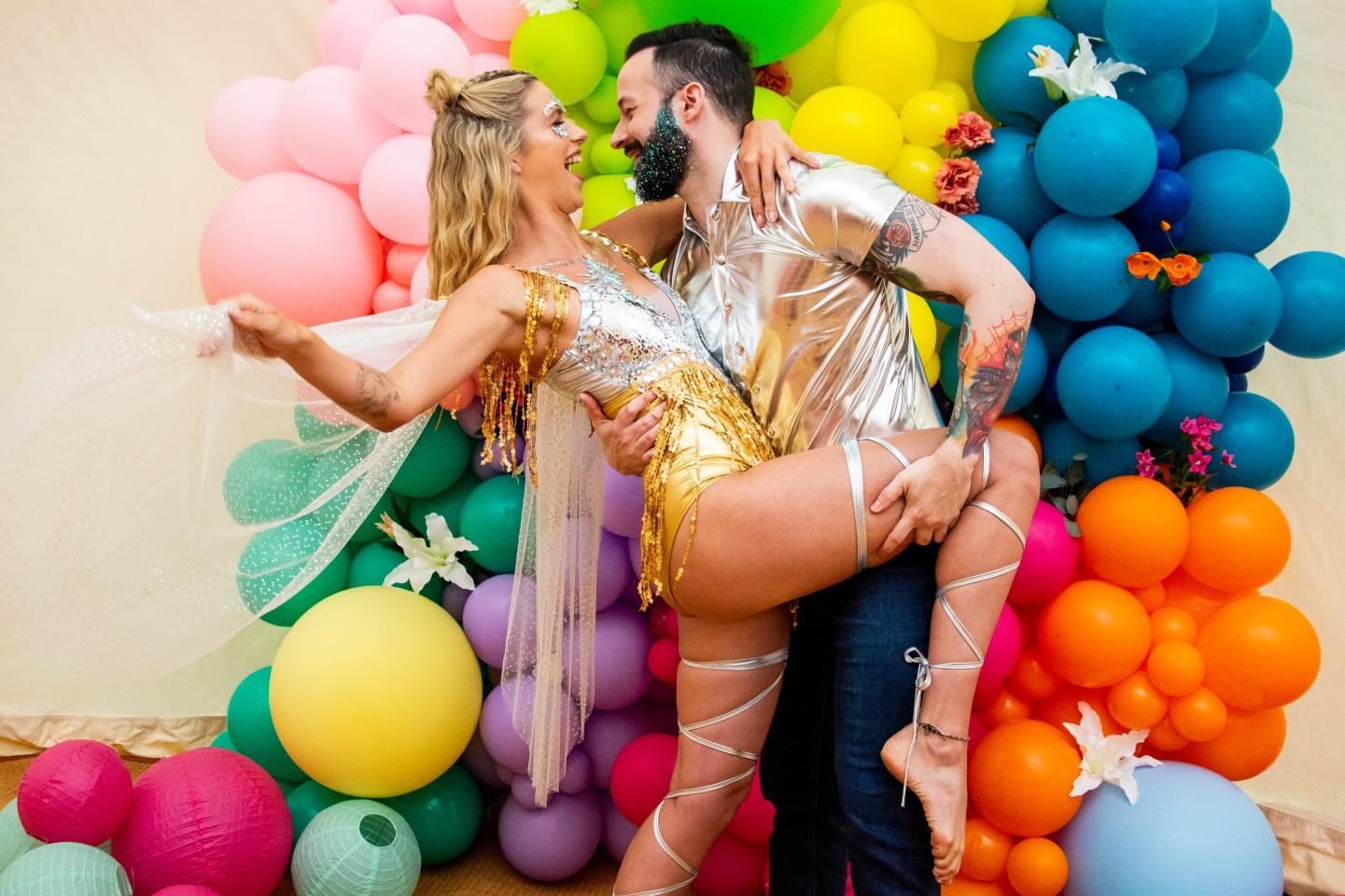 sparkly festival wedding - rainbow wedding - colourful wedding - sparkly wedding wear - colourful wedding backdrop - colourful wedding balloons - festival bride - fun wedding