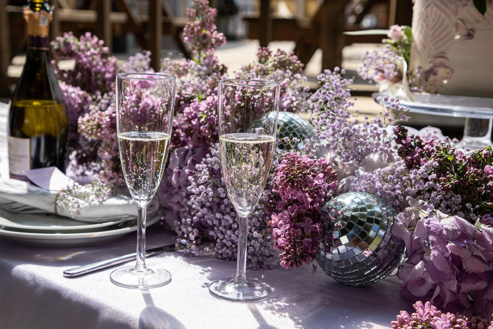 modern festival wedding - unique wedding wear - wedding jumpsuit - wedding catsuit - festival bride - unique wedding wear - purple wedding flowers - disco ball wedding decor