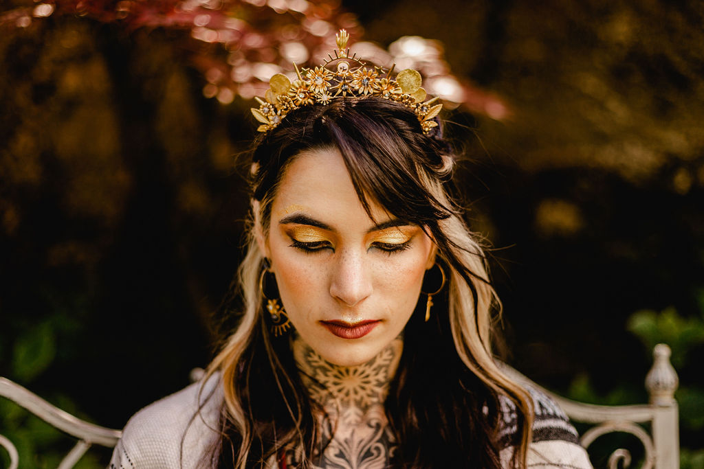 tattooed bride with gold headpiece and unique bridal makeup
