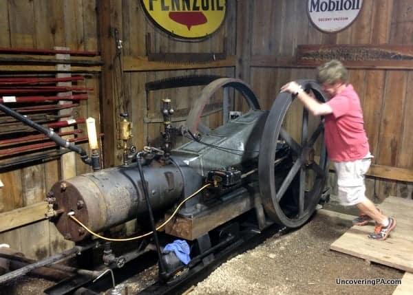My guide starting the vintage equipment at the Penn-Brad Oil Museum in Bradford, Pennsylvania.