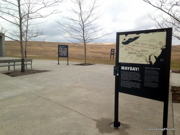 The open plaza contains several signs with information about the events of September 11, 2001 and Flight 93.
