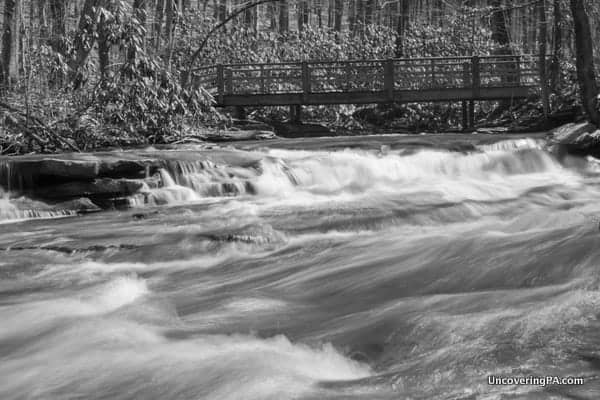 The cascading Jonathan Run flows below a bridge on the Jonathan Run Trail.