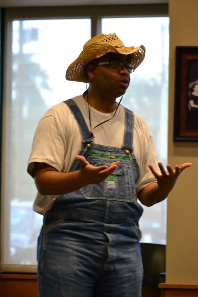 """Adrian Miller speaks in costume as a sharecropper at the book launch for """"Soul Food,"""" 8/17/2013 Denver Public Library"""