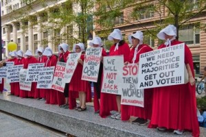 "Image caption: Charles Edward Miller, ""Illinois Handmaids Stop Brett Kavanaugh Rally Downtown Chicago Illinois 8-26-18"""