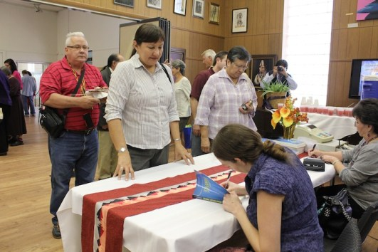 Jean Dennison signs copies of her book following the Sept. 29 Osage constitutional reform roundtable