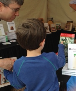 "A young fan discusses James McPherson's ""War on the Waters"" with his dad, Southern Festival of Books 2012"