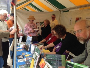 Customers fill the booth while author Bill Finch eyes the camera suspiciously, Southern Festival of Books 2012