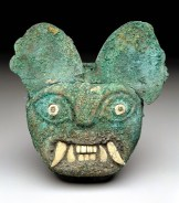 Ornament in the form of a feline face, Moche, Early Intermediate period, Moche Phase II-III, c. A.D. 100-450, gilded copper, shell, and turquoise, Dallas Museum of Art, The Nora and John Wise Collection, bequest of John Wise, 1983