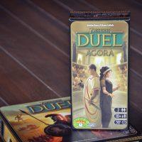 [Extension] 7 Wonders Duel : extension Agora ; les complots et intrigues politiques entrent en scène. Et petit retour sur une référence du jeu à deux...