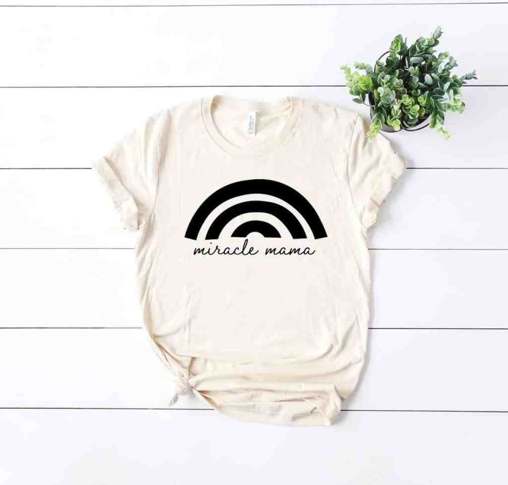 cream-tee-shirt-that-says-miracle-mama-with-rainbow-on-top-this-is-a-great-rainbow-baby-tee-gift