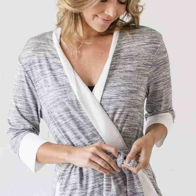blonde woman tying robe